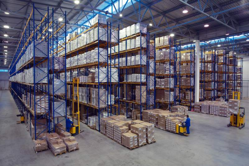 Large Warehouse With Many Pallets And Packages