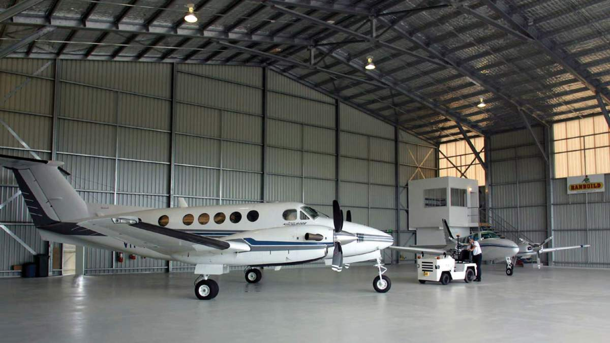 Large Aircraft Hangar With Two Small Private Aeroplanes