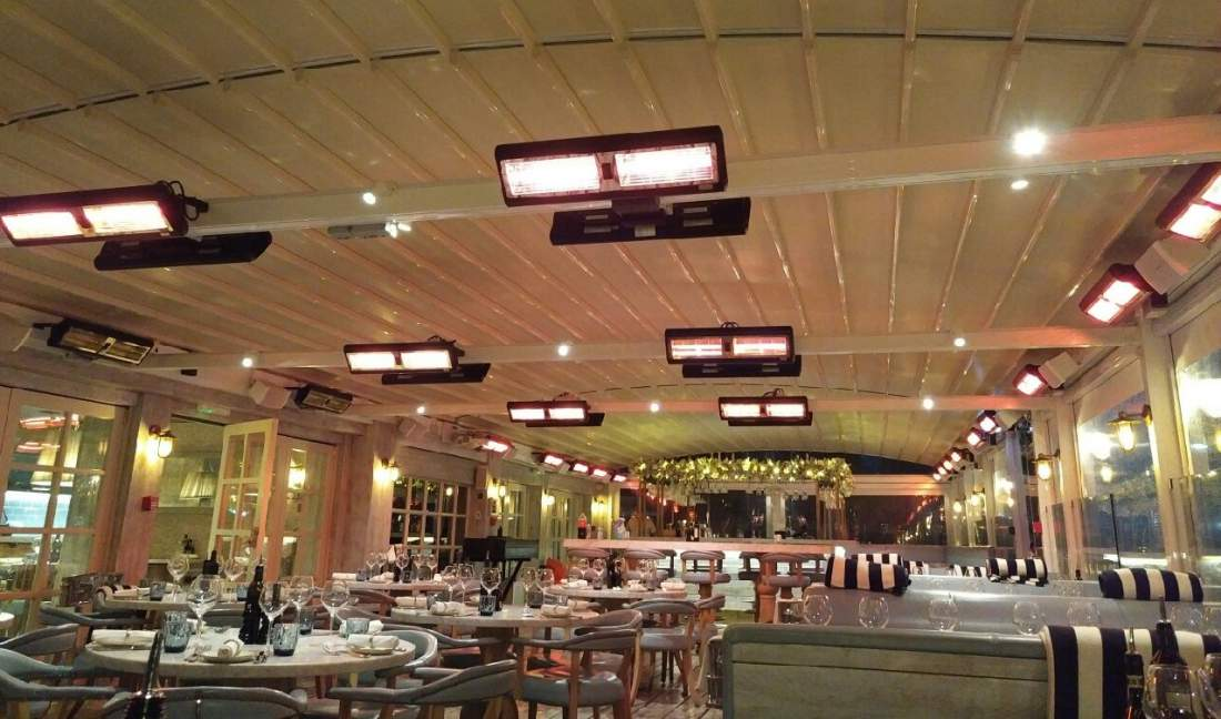 1311-Tansun-Sorrento-double-infrared-heaters-heating-dining-area-underneath-retractable-awning.jpg