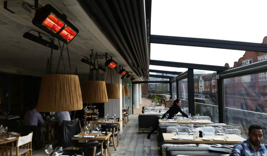 Tansun Monaco Double Low Glare Infrared Heaters Heating Outdoor Dining Area At Bank Restaurant