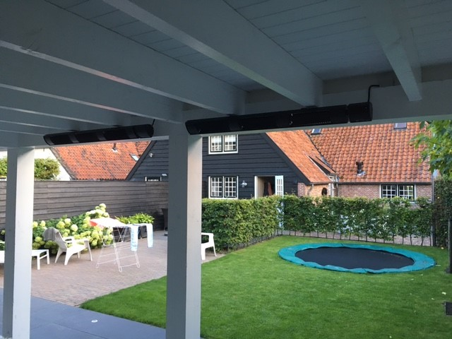 Tansun Eclipse No Glare Infrared Heater Installed In Awning Of Garden