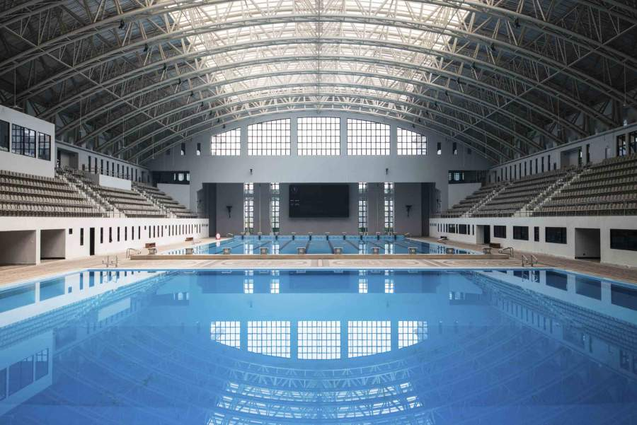 Two Large Swimming Pools With Spectator Seating Areas