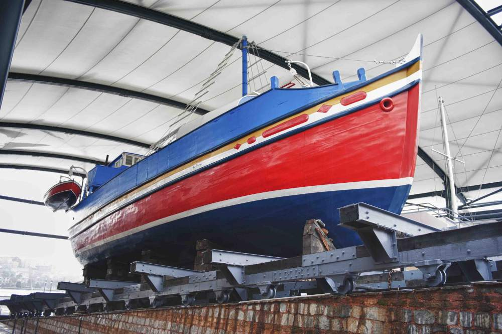 Large Boat Inside A Boatyard Next To The Sea