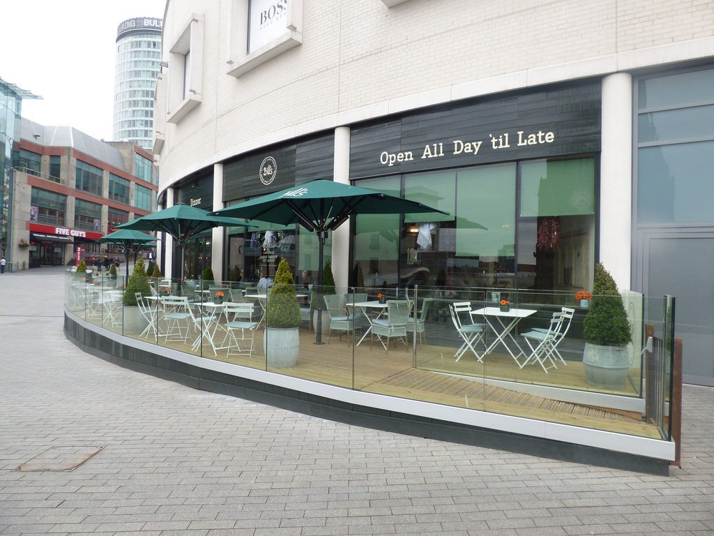 Restaurant Outdoor Eating Area with Parasols with Infrared Heaters
